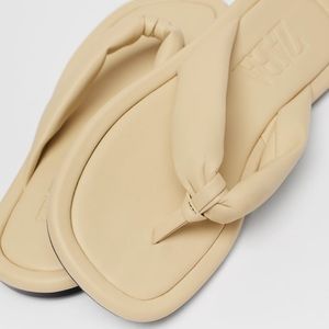 Quilted low flat sandals a limited edition beige